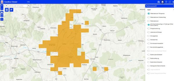 """Bild 1: Geobox-Anwendung mit aktivierter Karte """"jährlicher Niederschlag im 10-jährigen Mittel kleiner 550 mm"""". Betroffene Areale sind mit den ockerfarbenen Kacheln hervorgehoben"""